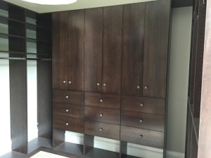 Wilmette. The master drawers are in a solid wood with a shaker ogee style face. The other room is Euro Slab doors with a solid wood face 4